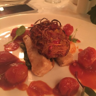 Seared Tofu Cinnamon and chilli dusted tofu, presented on wilted spinach and topped with vegetable bhaji and tomato ragout